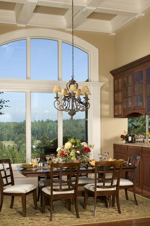 Traditional Dining Room with Box ceiling, High ceiling, Chandelier, Built-in bookshelf, Hardwood floors, Crown molding