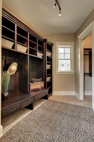 Traditional Mud Room with Project Source 4-Light Bronze Gimbal Linear Track Lighting Kit, limestone tile floors, flush light