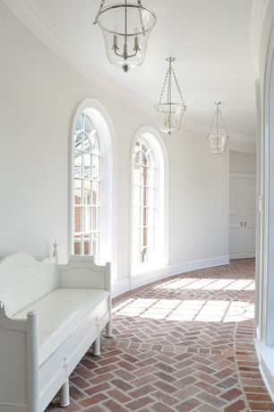 Traditional Hallway with Crown molding, Brick floors, Chandelier, Arched window, French doors
