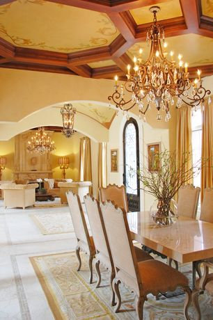 Mediterranean Dining Room with Traditional brass and crystal chandelier, French doors, French oak side chairs, Exposed beam