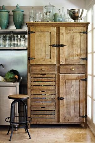 Rustic Kitchen with Distressed wood cabinet, Raised panel, Stainless steel floating shelves, limestone tile floors, One-wall
