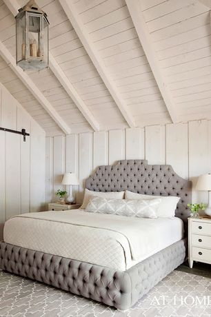 Contemporary Master Bedroom with Exposed beam, Standard height, Pendant light, Hardwood floors