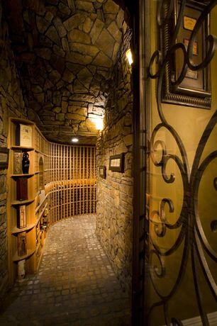 Mediterranean Wine Cellar with specialty door, Built-in bookshelf, Wall sconce