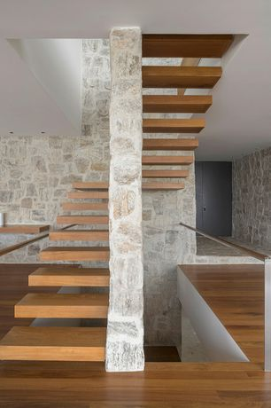 Contemporary Staircase with Hardwood floors, Columns, High ceiling, Floating staircase
