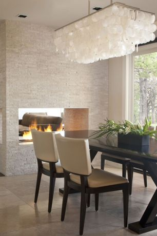 Contemporary Dining Room with Fireplace, Standard height, Concrete tile , can lights, Chandelier, brick fireplace, Casement