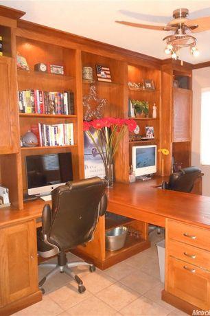 Traditional Home Office with Crown molding, Ceiling fan, Built-in bookshelf, limestone tile floors, Built in shelves