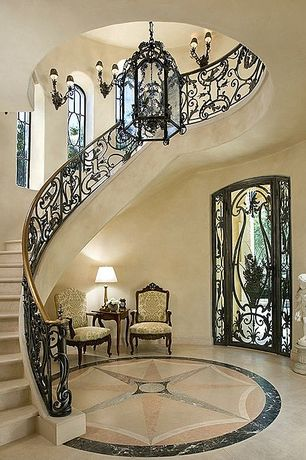 Mediterranean Staircase with Standard height, Arched window, Wall sconce, Concrete floors, curved staircase