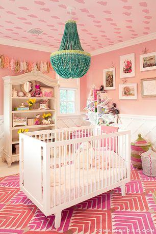 Contemporary Kids Bedroom with Wainscotting, Carpet, Crown molding, Confettisystem tassel garland-pink/peach, flush light
