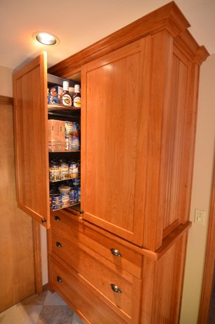 Country Pantry with flat door, stone tile floors, Built-in bookshelf, Paint 1, can lights, Standard height, slate tile floors
