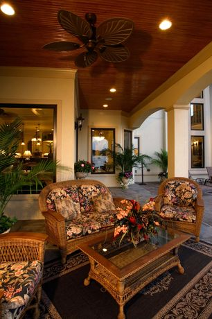Tropical Porch with picture window, exterior stone floors