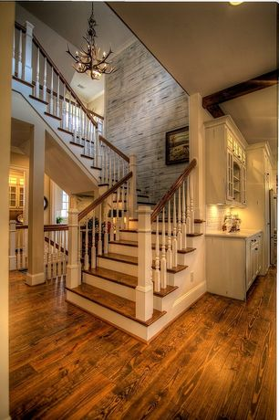 Country Staircase with Columns, Hardwood floors, High ceiling, Chandelier, Faux antler 6-light chandelier, Spiral staircase