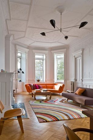 Eclectic Living Room with Herringbone parquet flooring, Stucco fireplace, Knoll eames molded plywood lounge chair (lcw), Sofa