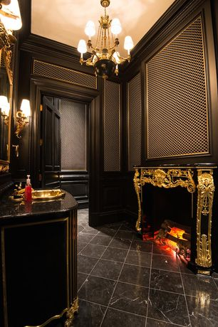 Art Deco Powder Room with Black and gilt fireplace mantle with neoclassical motif, Wall sconce, Crown molding, Pendant light