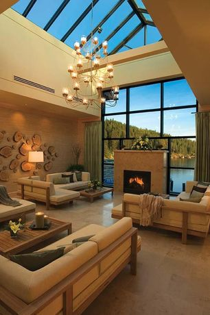 Contemporary Living Room with Chandelier, Exposed beam, Cathedral ceiling, Skylight, interior wallpaper, Cement fireplace