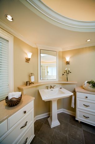 Traditional Master Bathroom with Travertine counters, Skylight, Raised panel, Flat panel cabinets, Crown molding, Wall sconce