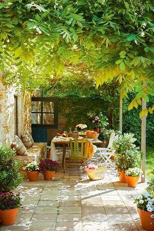 Mediterranean Patio with Trellis, Fence, Outdoor seating area, Casement, exterior stone floors