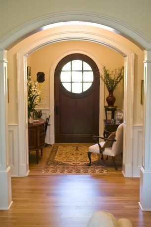 Traditional Entryway with Chair rail, Paint 1, Columns, Standard height, Cabinet-demilune-3 drawer, Glass panel door, Paint 2