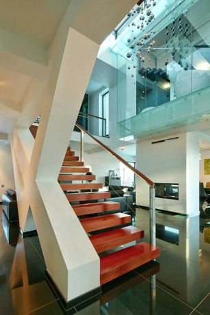Contemporary Staircase with High ceiling, Hardwood floors, Floating staircase