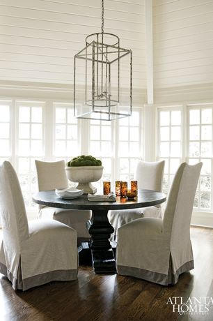 Cottage Dining Room with Hardwood floors, Casement, Slipcovered dining chair, Home styles arts and crafts table, High ceiling