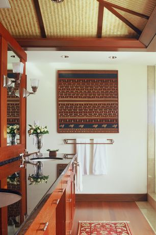 Tropical Master Bathroom with Laminate floors, Undermount sink, Oregon Tile & Marble Black Absolute Super Granite, Flush