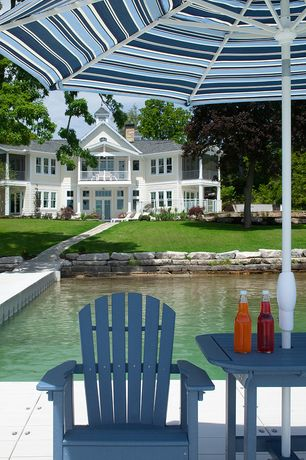 Traditional Deck with Pond, Deck Railing, Paint 1, Fantasy 9-foot multi-color umbrella with crank, French doors, Pathway