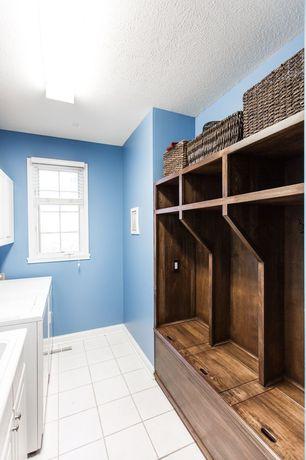 Traditional Mud Room with Pottery Barn Havana Lidded Baskets, Built-in bookshelf, limestone tile floors, flush light