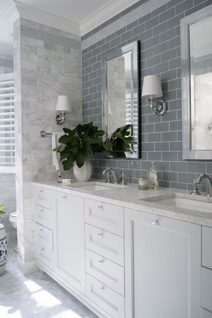 Traditional Full Bathroom with Complex marble counters, Subway Tile, Plantation shutters, penny tile floors, Crown molding
