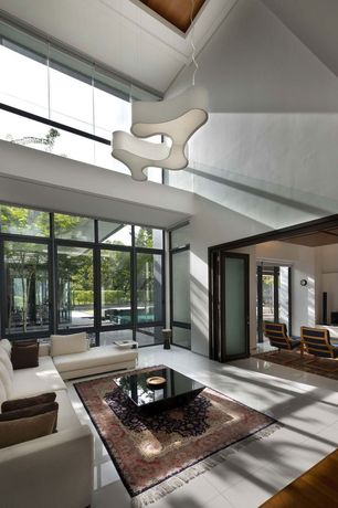 Contemporary Great Room with folding door, High ceiling, Chandelier, picture window, French doors, Ikea poang chair