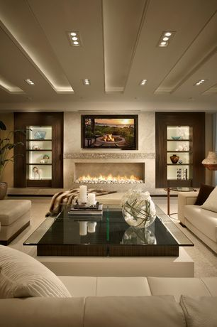 Contemporary Living Room with Built-in bookshelf, Carolina accents belle meade slipper chair, Standard height, Fireplace