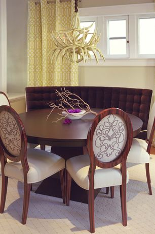 Contemporary Dining Room with Chandelier, Antler chandelier, Columns, White leather oval back dining chair, Tufted banquette