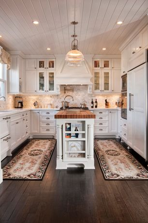 Traditional Kitchen with Pendant light, Complex marble counters, Kitchen island in white, Custom hood, Flat panel cabinets