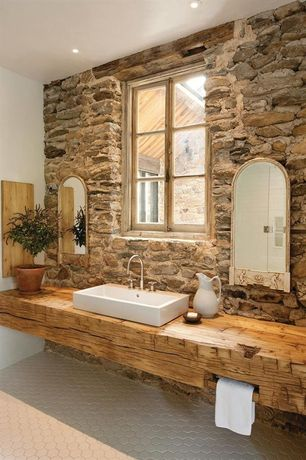 Rustic Full Bathroom with White porcelain pitcher, Vessel sink, Wood counters, frameless showerdoor, penny tile floors