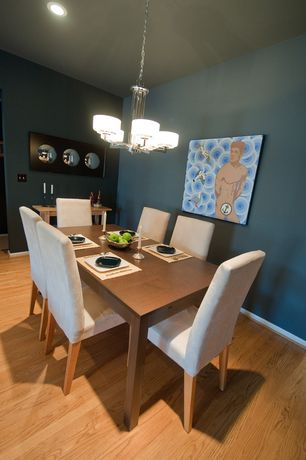 Contemporary Dining Room with Hardwood floors, Chandelier
