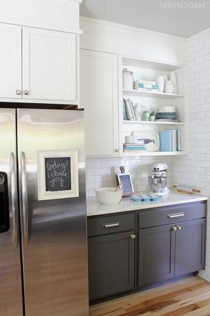 Contemporary Kitchen with White subway tile, Kitchenaid stand mixer, Stainless steel refrigerator, One-wall, Corian counters