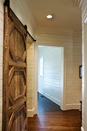 Country Hallway with Crown molding, Barn door, Hardwood floors