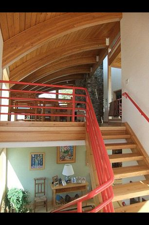 Country Staircase with Hardwood floors, High ceiling, Spiral staircase, Exposed beam