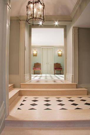 Traditional Hallway with French doors, Crown molding, stone tile floors, simple marble tile floors, can lights, Wall sconce