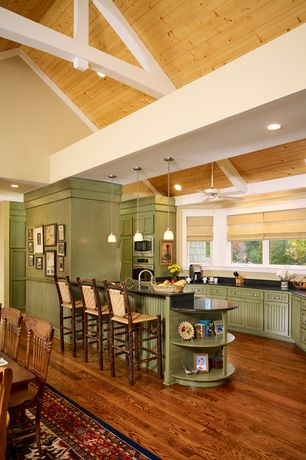 Country Kitchen with High ceiling, Pendant light, Breakfast bar, Framed Partial Panel, double wall oven, Soapstone counters