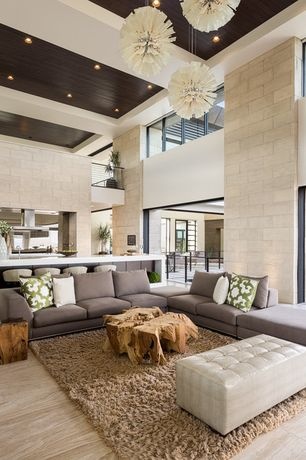 Contemporary Living Room with Haussman: wooden cube 18 walnut oil end table, Clerestory window, Limestone wall, Shag area rug