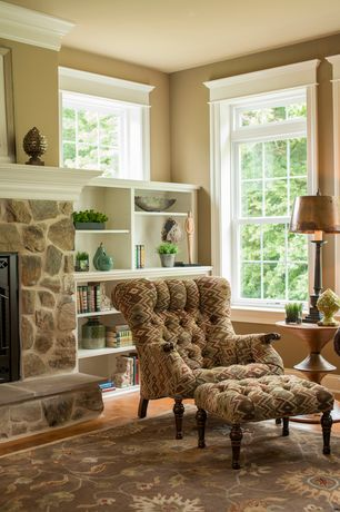 Traditional Living Room with Built-in bookshelf, Hardwood floors, stone fireplace