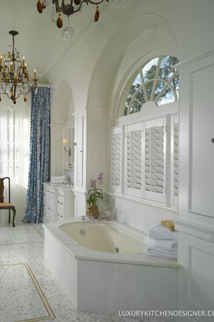 Traditional Master Bathroom with Arched window, Crown molding, Cathedral ceiling, drop in bathtub, ceramic tile floors
