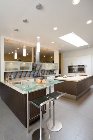 Modern Kitchen with European Cabinets, Skylight, Large Ceramic Tile, Glass counters, Pendant light, U-shaped, Undermount sink