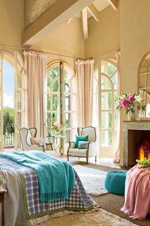 Traditional Master Bedroom with specialty door, interior brick, High ceiling, Paint, stone fireplace, French doors, Fireplace