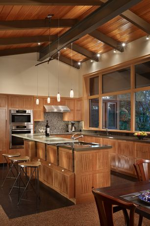 Contemporary Kitchen with Paint1, Casement, Paint, Kitchen island, Paint 2, Flush, Wall Hood, can lights, L-shaped