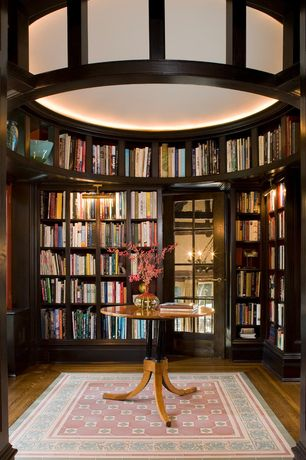 Traditional Library with Glass panel door, Built-in bookshelf, picture window, Hardwood floors, Standard height