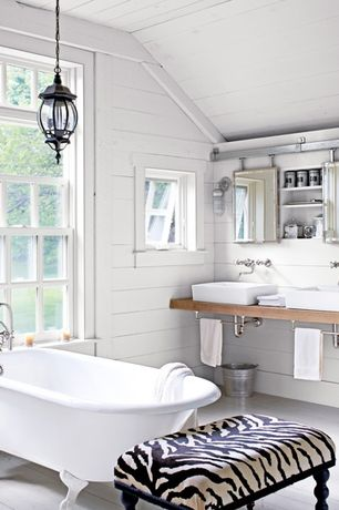 Traditional Master Bathroom with Hardwood floors, Bathtub, Wall sconce, Wood counters, Paint, Double sink, Zebra Vanity Stool