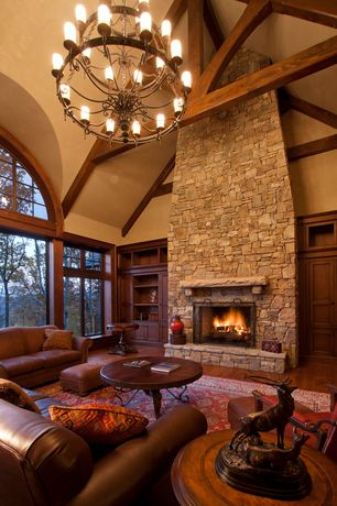 Country Living Room with Hardwood floors, Arched window, stone fireplace, Iverside furniture stone forge coffee table, Paint