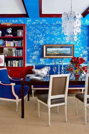Eclectic Dining Room with Built-in bookshelf, interior wallpaper, Wainscotting, Hardwood floors, Chandelier, Crown molding