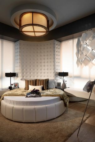 Master Bedroom with High ceiling, flush light, Hardwood floors, Window seat, interior wallpaper