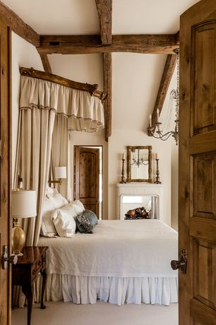 Rustic Master Bedroom with Flanders chandelier, 19th century french carved door headboard, Exposed beam, Chandelier, Carpet